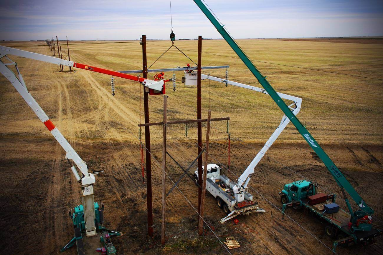 K-line workers in buckets working on transmission lines