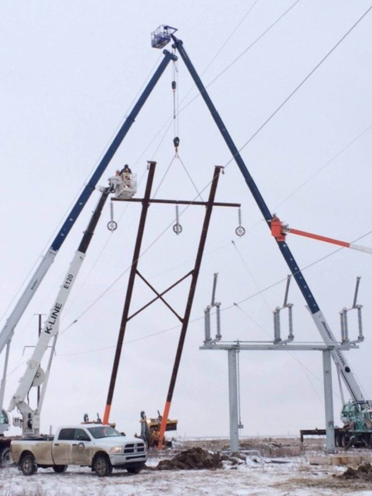 Erecting a transmission tower with cranes