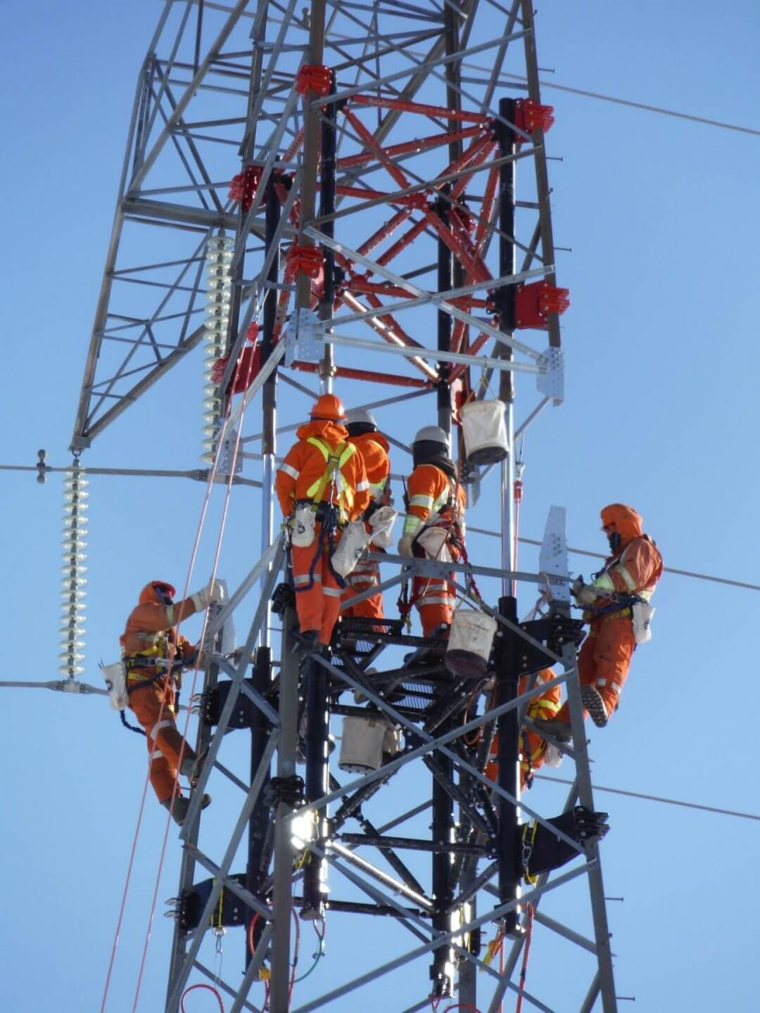 Workers on transmission tower