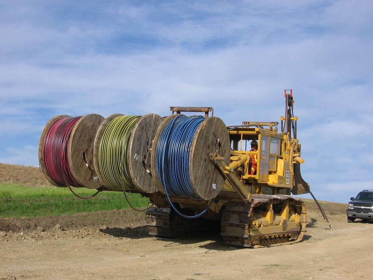Cable tractor carrying 3 underground cable spools