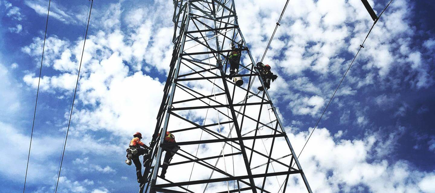 Transmission tower with workers
