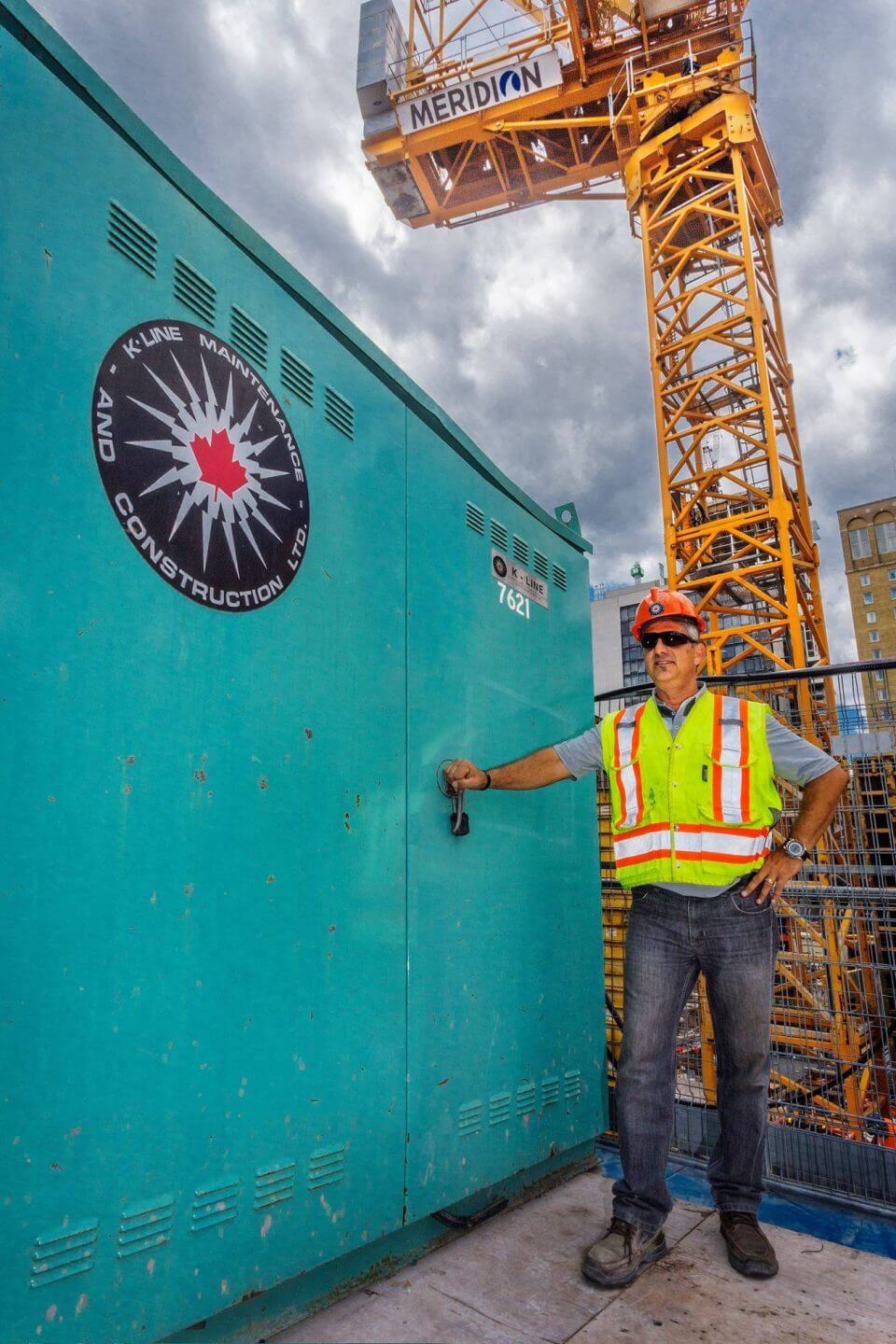 K-Line employee standing beside temporary power unit