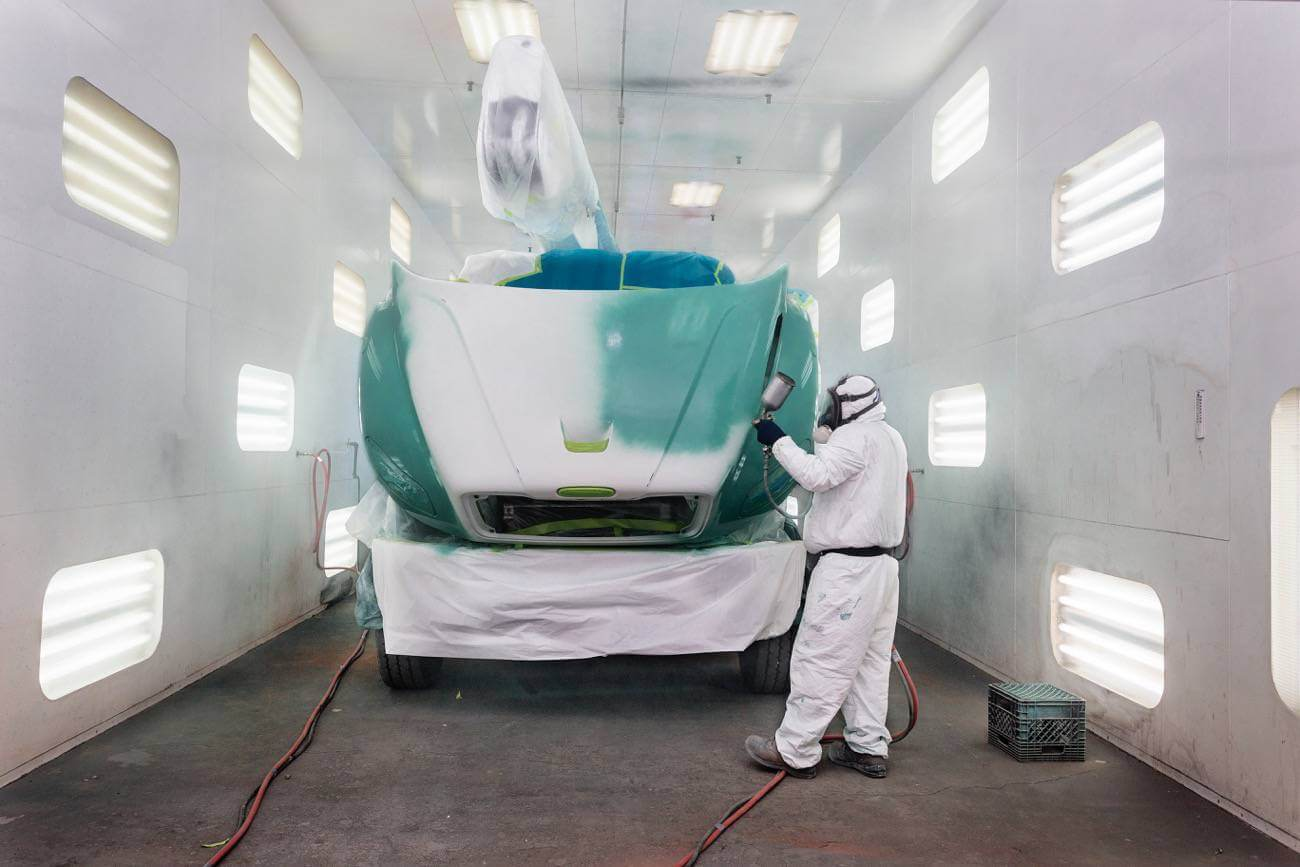K-Line worker painting a fleet truck