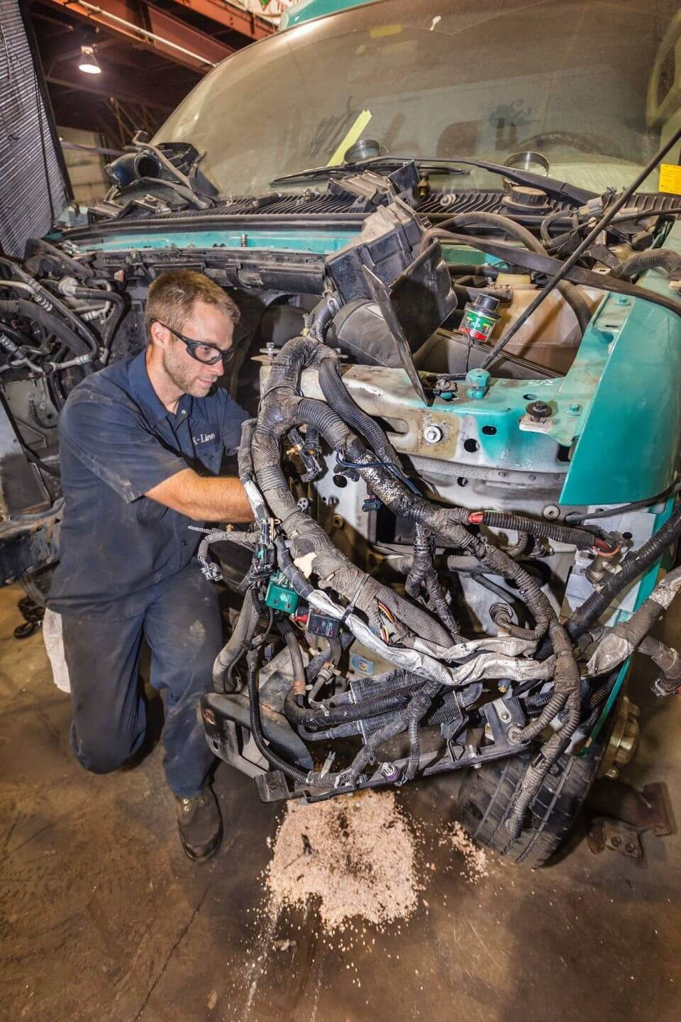 Employee working on a K-Line truck engine