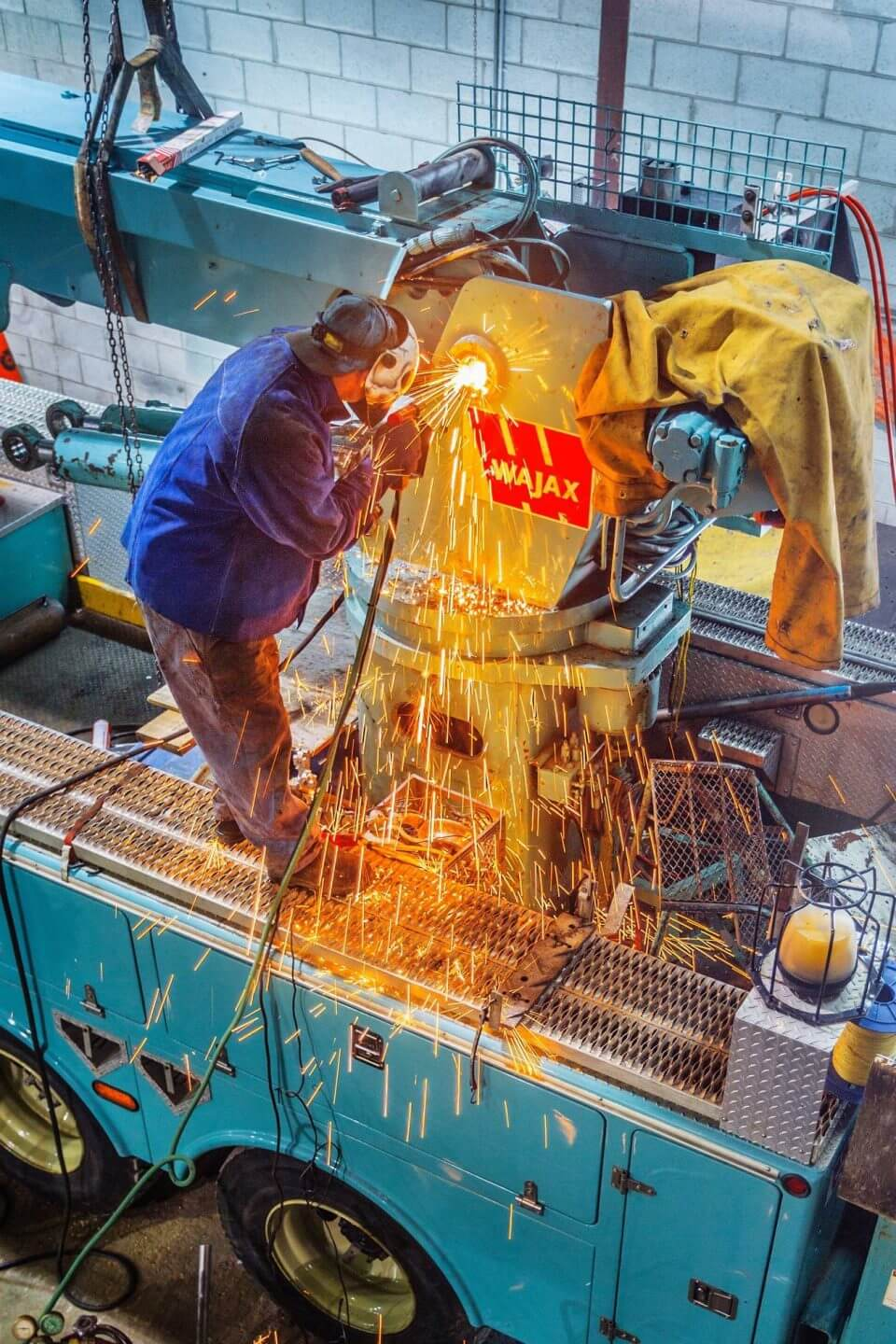 Welder working on a K-Line truck
