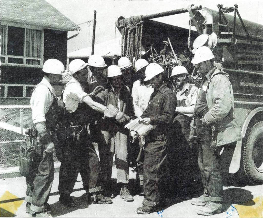 E. Glenn Kellett (pictured far right) participating in a tailboard discussion with Ontario Hydro in the early 1960's