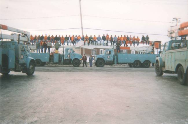 Workers sitting on a K-Line truck - 1998