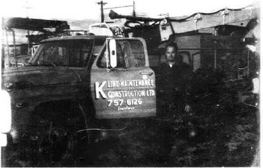 Glenn pictured with one of K-Line's first utility trucks, 1967