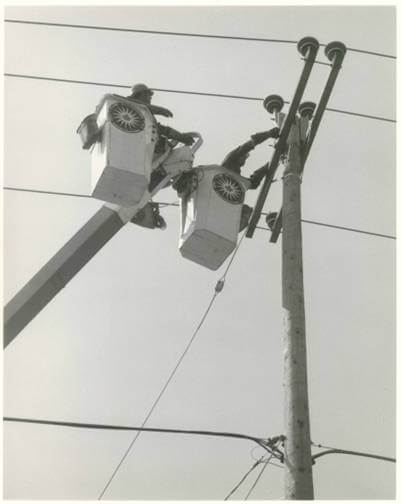 Utility workers working on lines