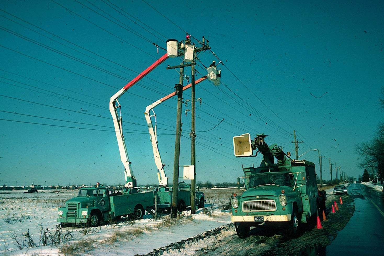 Utility workers working on roadside lines