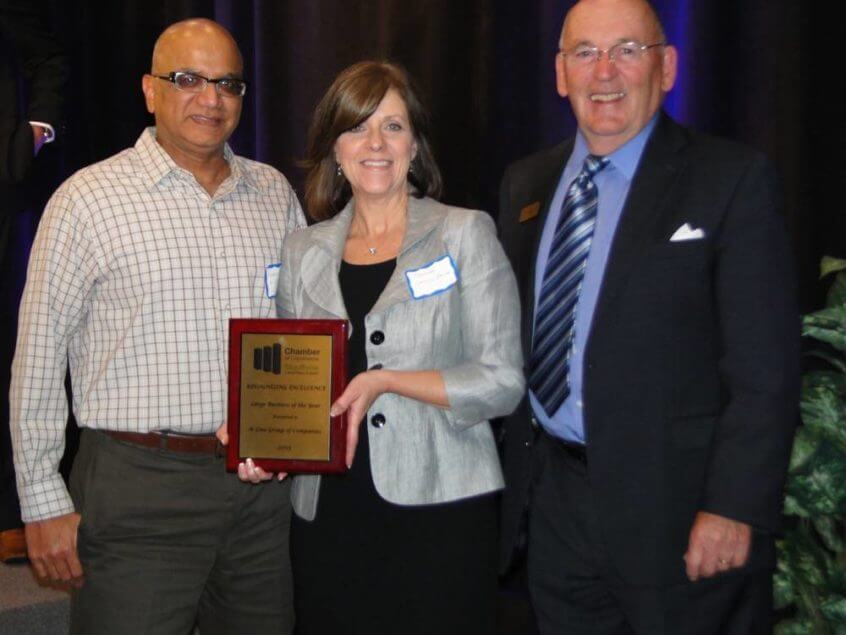 Georgia Stevens, Manger-Human Resources, and Saleem Sheikh, Payroll Supervisor, accepting the award on behalf of K-Line.
