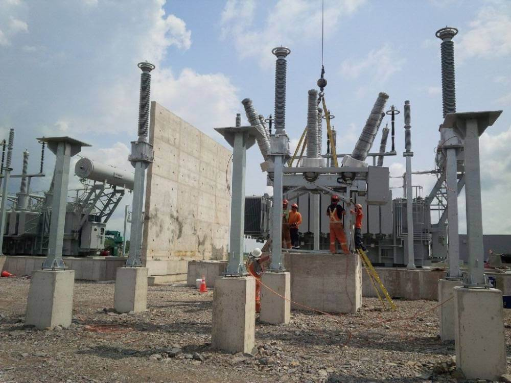 K-Line workers working on a substation